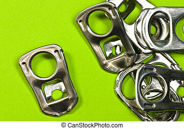 ring pulls on green background