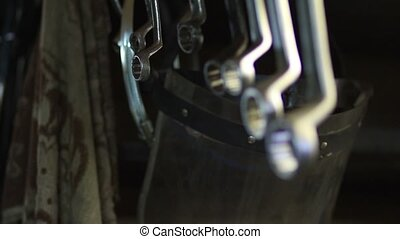Ring spanners rendered hanging in workshop - Close up view...