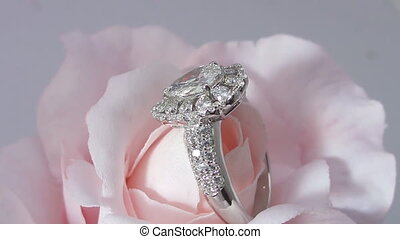 ring with diamonds on a rotating stand rose (close-up)