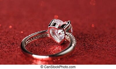Ring with large heart shaped diamond rotating on red shiny...