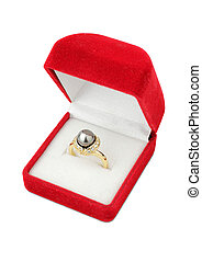 Ring with pearl in jewelry gift box isolated on white