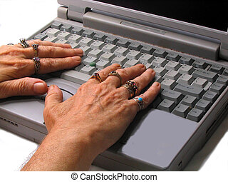 ,ringed fingers on a keyboard