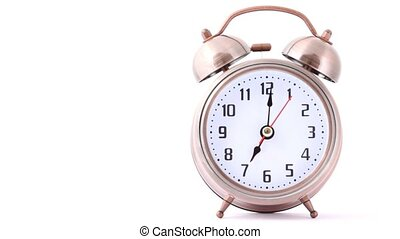 ringing classical alarm clock on white, front view