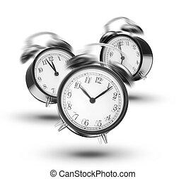 Ringing alarm clocks on white background