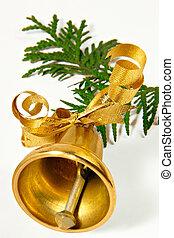 Ringing handbell on a coniferous branch