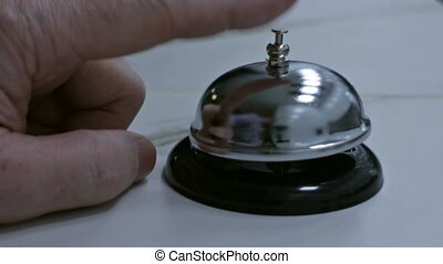 ringing table bell - Person rings a table bell at the hotel...