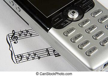 Ringtone II - A closeup of a cellular phone over a...