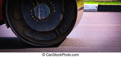 rink rolls asphalt