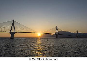Rio antirrio suspended bridge at sunset in Greece