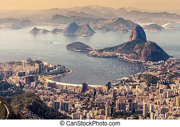 Rio de Janeiro, Brazil. Suggar Loaf and Botafogo beach viewed from Corcovado