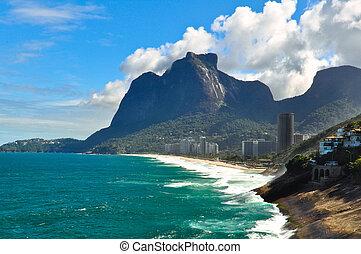 Sao Conrado beach and Pedra da Gavea mountain.