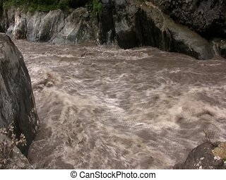 Rio Pastaza, Ecuador in flood - Near Banos, Ecuador. In the...