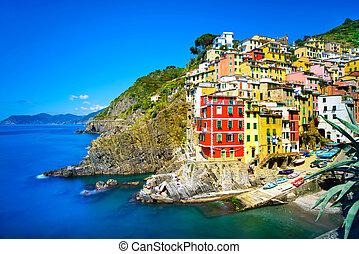 Riomaggiore village on cliff rocks and sea at sunset.,...