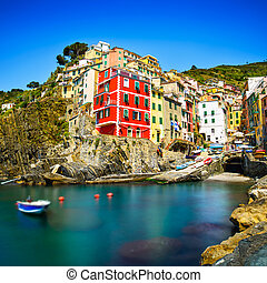 Riomaggiore village on cliff rocks and sea at sunset.,...