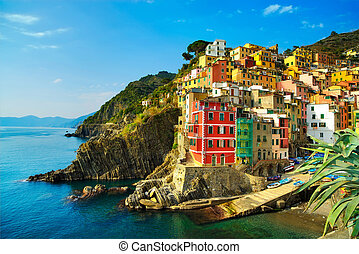 Riomaggiore village, rocks and sea at sunset. Cinque Terre,...