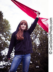 Riot act of a female activist - Determined young woman in a...