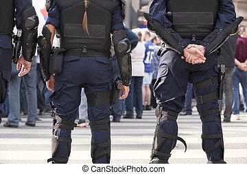 police - Riot police preparing for trouble at an...