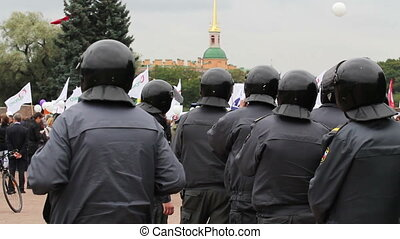 Riot police row, Russia - HD 1080p: Riot police row watching...