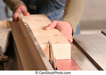Rip - A piece of pine being ripped on an industrial tablesaw...