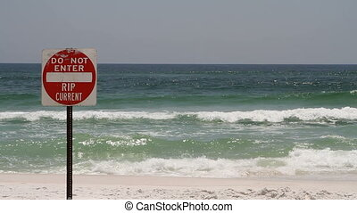 Rip Current Danger Sign - Posted sign warns swimmers that...