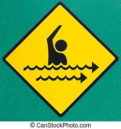 Rip current hazard symbol warning sign on green