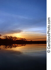 Riparian Sunset - Colorful Winter Sunset and Silhouette of ...