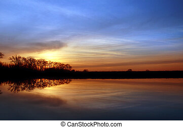 Riparian Sunset - Colorful Winter Sunset and Silhouette of...