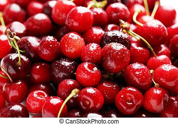 Ripe and fresh cherries background, close up