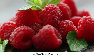 Ripe appetizing raspberry with leaves - Closeup ripe fresh...