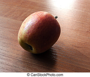 Ripe apple on the table