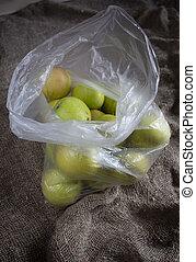 Ripe apples in a plastic bag