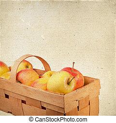 Ripe apples in a wicker basket.