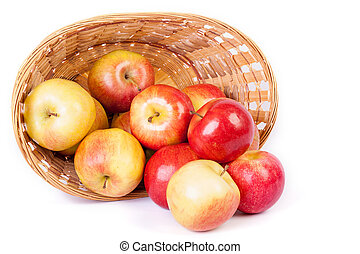 Ripe apples in basket on white background