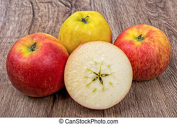 Ripe apples on a wooden background