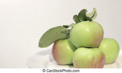 Ripe apples on plate.