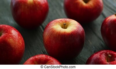 Ripe apples on wooden table - Closeup heap of red fresh...