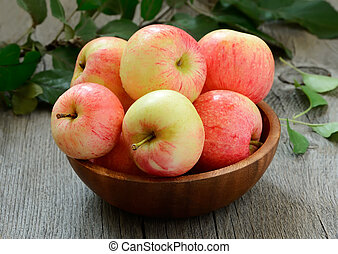 Ripe apples on wooden table