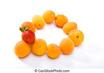 Ripe apricots and berry of strawberry on white background