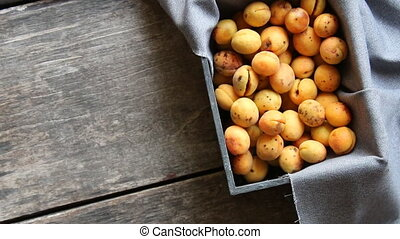 Ripe apricots in wooden box. Food background. - yellow sweet...