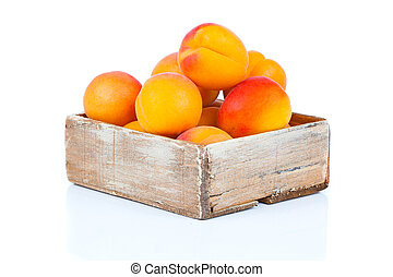 ripe apricots in wooden box, Isolated on white backgroun