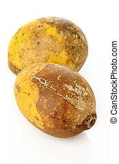 ripe bael fruit on white