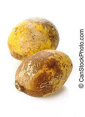 ripe bael fruit on white background