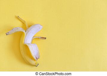Ripe banana on yellow background