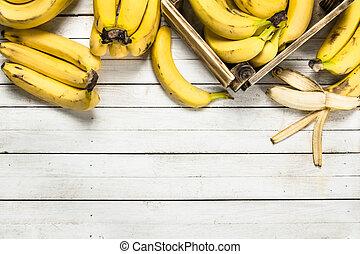 Ripe bananas in a box.