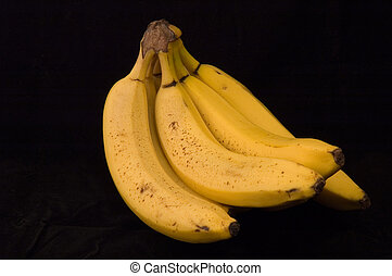 Ripe Bananas on a Black Background
