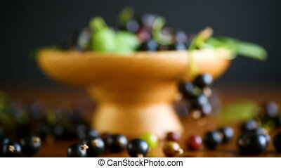 ripe berries black currants on a wooden table