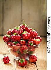 berries of garden strawberry in a glass vase