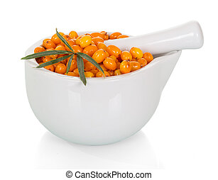 Ripe berries of sea-buckthorn in mortar with pestle isolated on white background.
