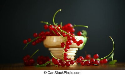 ripe berries red currants on a wooden table