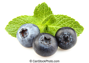 Ripe berry with leaves of mint